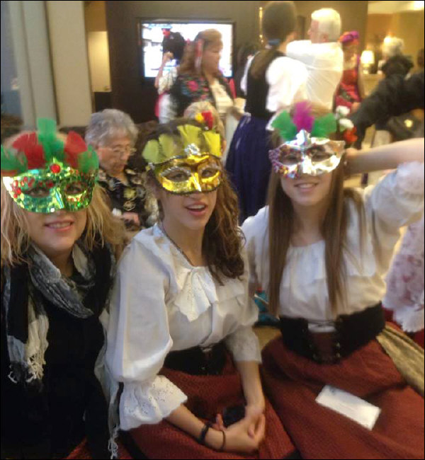 Three Festa attendees modeling their mask creations (2013)